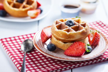 caramel sauce: waffles with strawberry and blueberry and caramel sauce