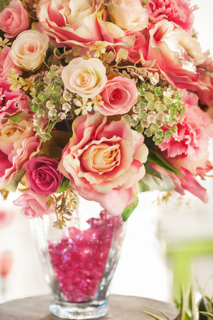 artificial flower: artificial flower bouquet in glass jar Stock Photo