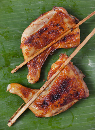brunt: thai grilled chicken  on banana leaf
