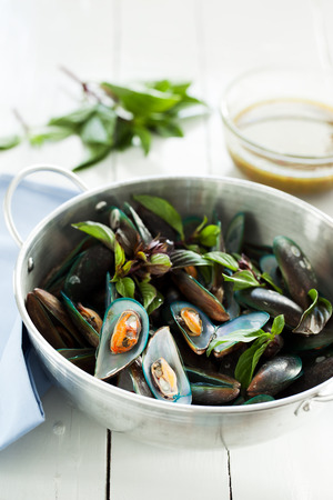 scald: scald mussel in stainless steel pot with spicy seafood sauce