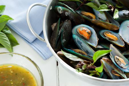 scald: scald mussel with spicy seafood sauce Stock Photo
