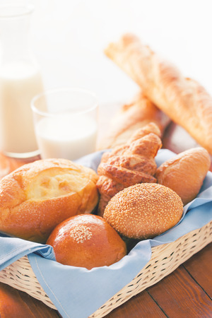 color effect: bun,bread and croissant in basket for breakfast with color effect