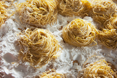 chinese noodles: homemade chinese noodles pile Stock Photo