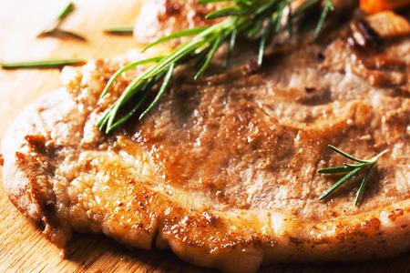 grilled pork chop: grilled pork chop  on wooden board