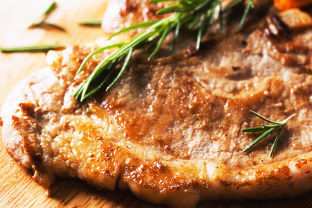 pork chop: grilled pork chop  on wooden board