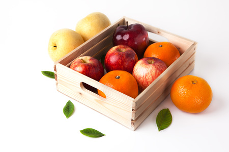 food box: vitamin c fruit in wooden box Stock Photo