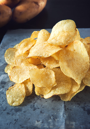 potato chips: homemade flavored potato chips pile Stock Photo