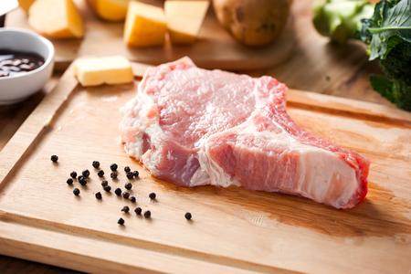 pork chop: pork prepare for make pork chop on chopping block