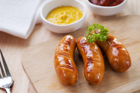 wooden block: grilled sausage on wooden block