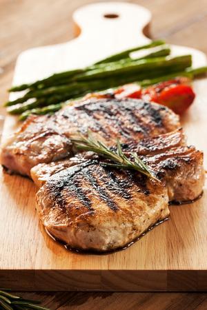 grilled pork chop: grilled pork chop on wooden board Stock Photo