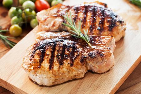 grilled pork chop: grilled pork chop with rosemary leaf