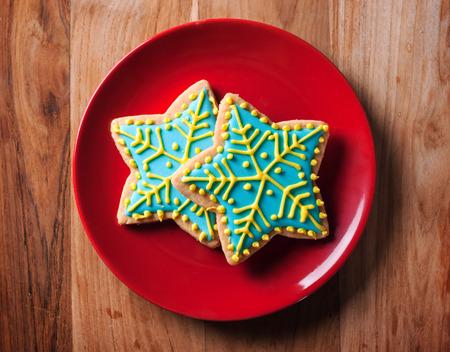 chirstmas: chirstmas snow flake cookies in red plate