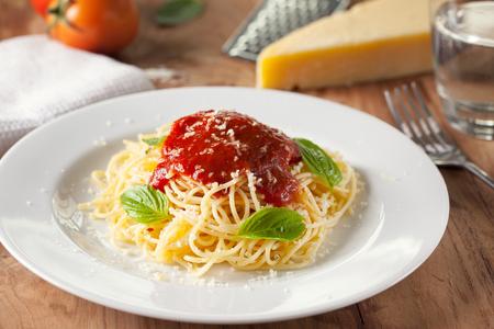 involve: spaghetti with tomato sauce in plate Stock Photo