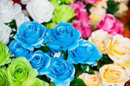 colorful artificial rose branch