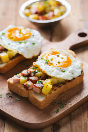 stir fried ham and tomato with fried egg sandwich Stock Photo