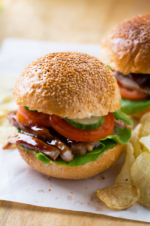 grilled pork sandwich with barbecue sauce Stock Photo