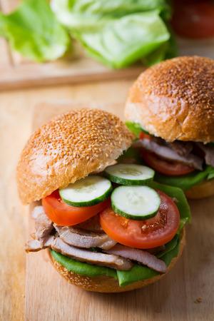 grilled pork sandwich on wooden board Stock Photo