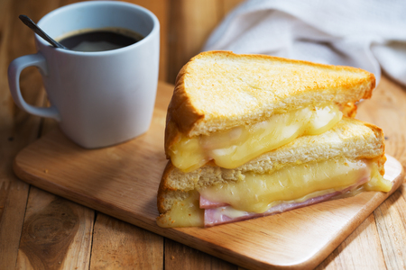 ham cheese sandwich for breakfast on wooden board Stock Photo