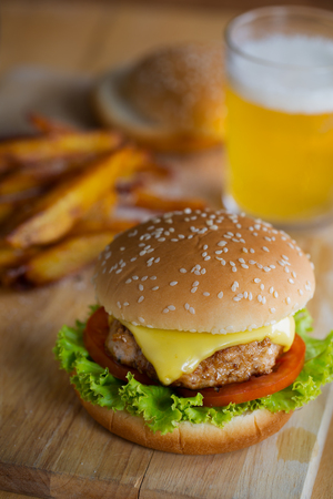 hamburger with french fries and beer