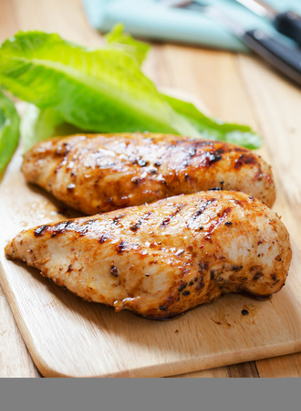 grilled chicken on wooden board
