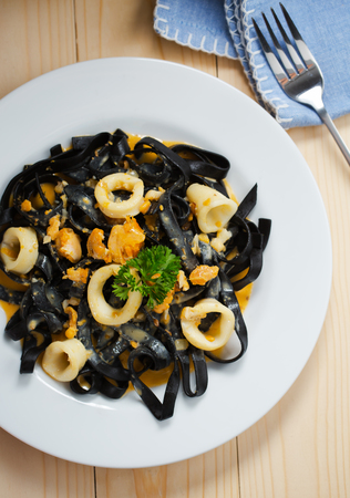 ink squid pasta with cuttlefish in plate Stock Photo