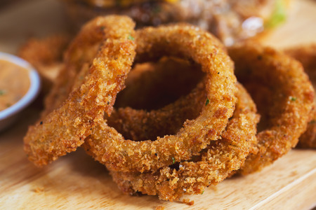cruncy onion ring on wooden board