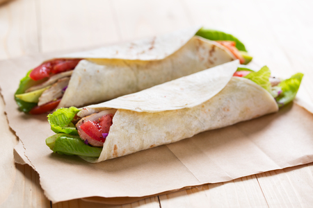 tortilla wrap with grilled chicken,avocado and vegetable for meal
