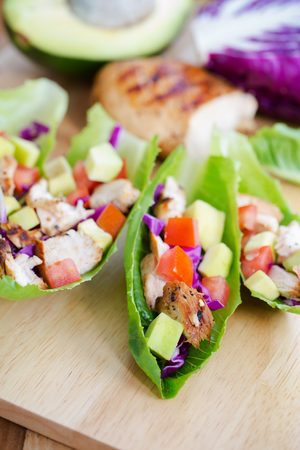 cos lettuce wrap with chicken,avocado,and tomato
