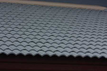 A roof tile on residential building construction house, gray color.