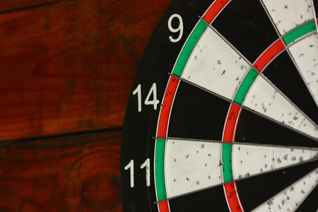 darts board hang on wooden wall zoom for number 14 免版税图像