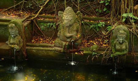 stillness: Old stone fountain in Ubud, Bali Stock Photo
