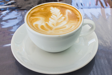 capacino: Cappuccino with latte art (coffee)