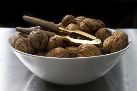 nut cracker: bowl with wallnuts and a nut cracker Stock Photo