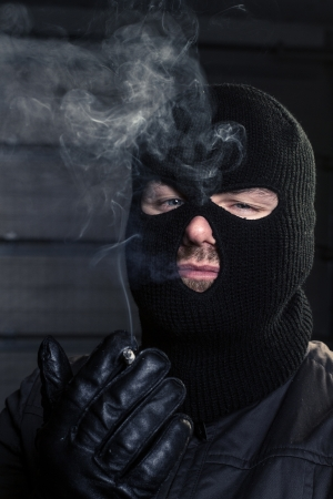balaclava: masked man smoking a cigarette