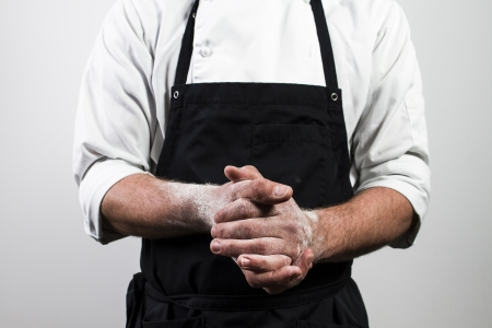 bakers: chef with flour on hands Stock Photo