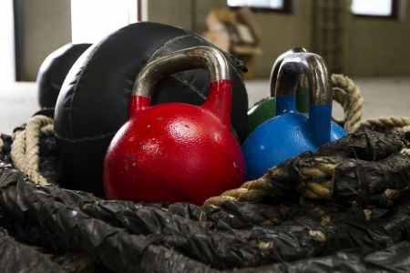 Kettle bells, rope and a medicine ball used for crossfit Stock Photo