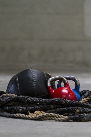 builds: Kettle bells, rope and a medicine ball used for crossfit Stock Photo