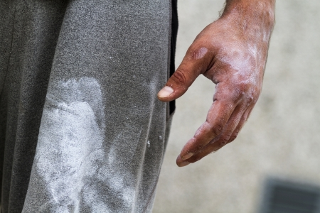 weight training: a sportsman with chalk on his hand Stock Photo