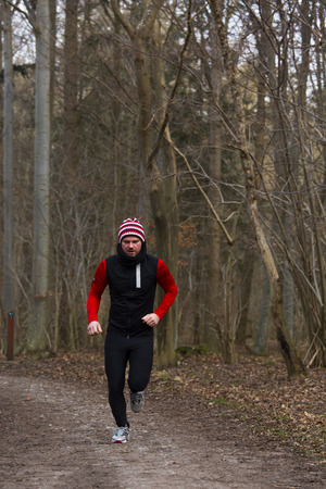 A man running outdoors in a forest photo