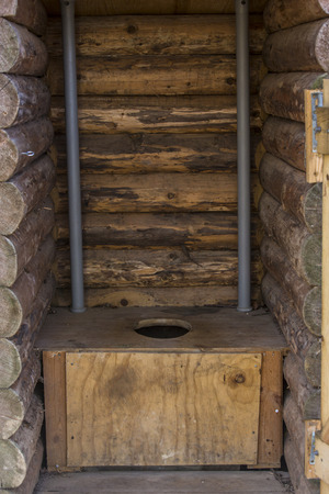outhouse: Rustic wooden outhouse