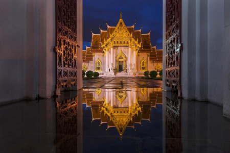 be soggy: Wat Benchamabophit in Bangkok at twilight time with reflection