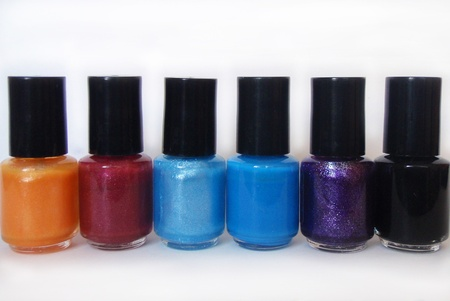 Colourful nail polishes in a line