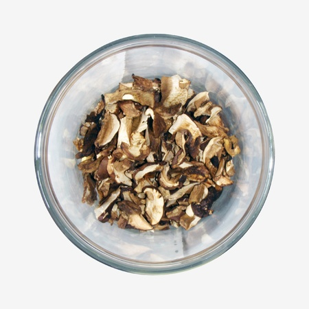 desiccation: Dried mushrooms in a see-through container Stock Photo