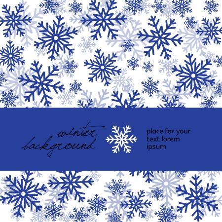 Copos de nieve azules sobre blanco, el lugar de texto