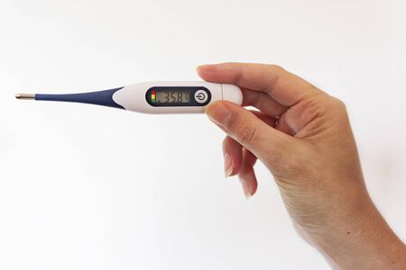digital thermometer isolated with hand on white background Stockfoto