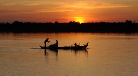Fishing boat at sunset on Mekong