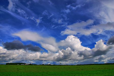 cirrus: Summer clouds form over a farm just before a storm.