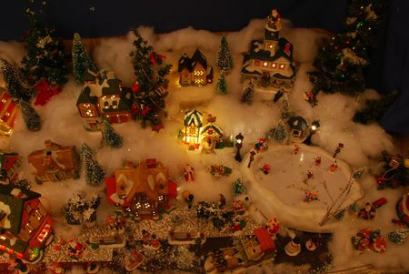 christmas carols: Looking down on a miniature Christmas village.  Kids are skating on the frozen pond.  Look closely and you might even find a Santa Claus or two, maybe more.