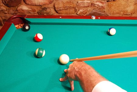 A High Angle On The Cue To Perform The Tricky Masse Shot To Stock - Masse pool table