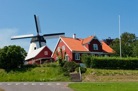 Old windmill in Aarsdale. Borholm Danish island. Tourist attraction. 新闻类图片